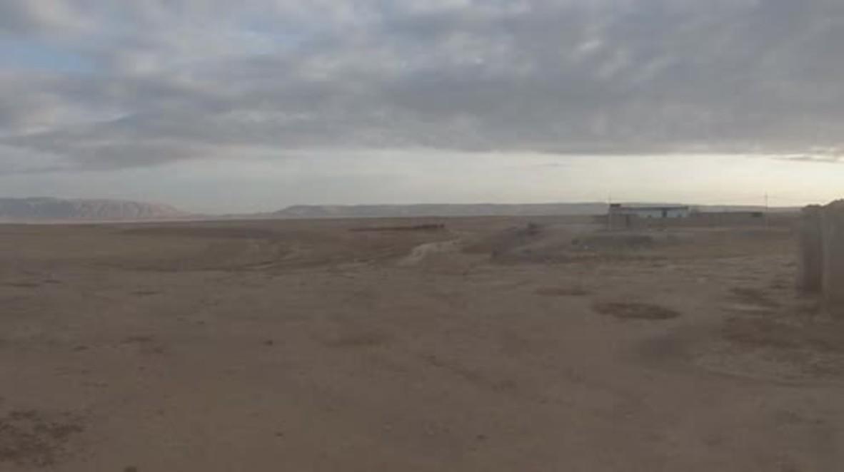 Syria: Kurdish forces clear mines along Syria-Iraq border as refugees gather