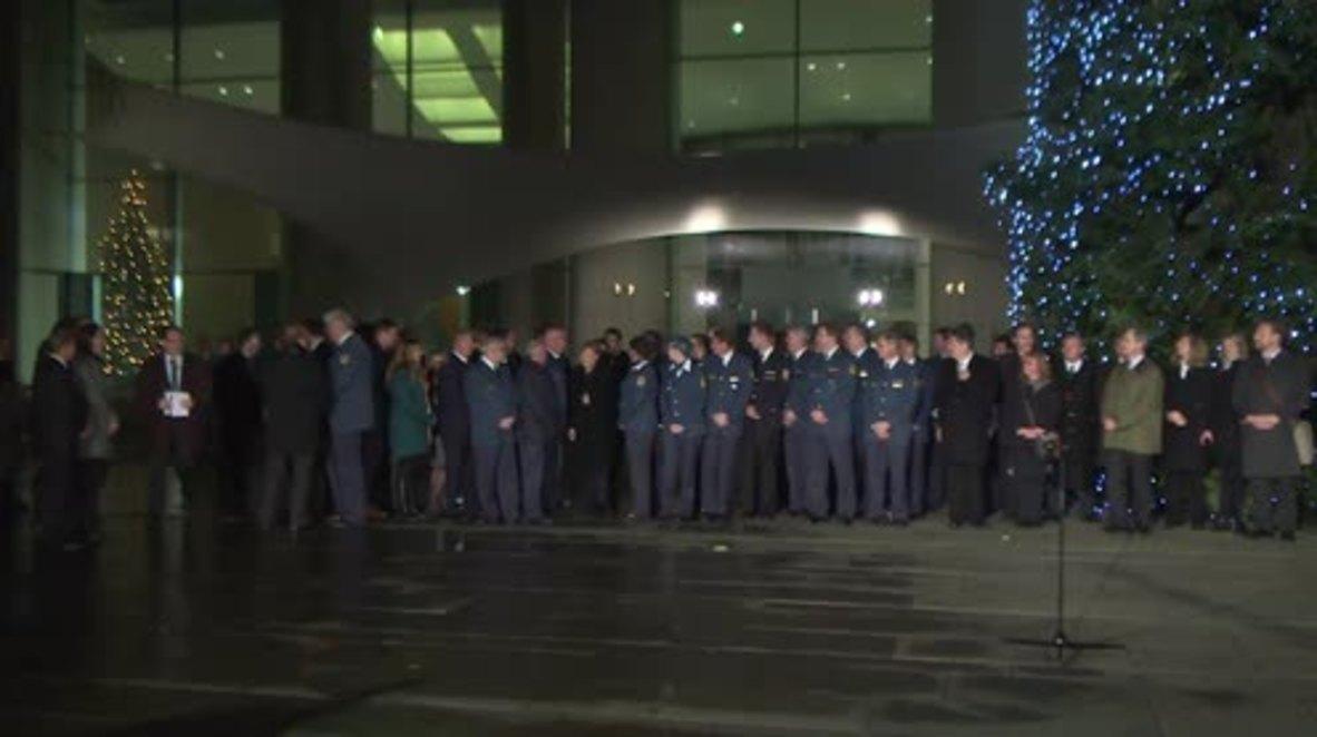 Germany: Merkel inaugurates Chancellery's towering Christmas trees