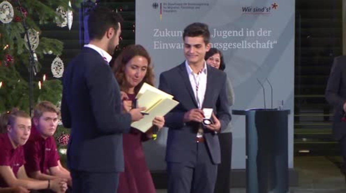Germany: Merkel awards refugee integration activists at Chancellery
