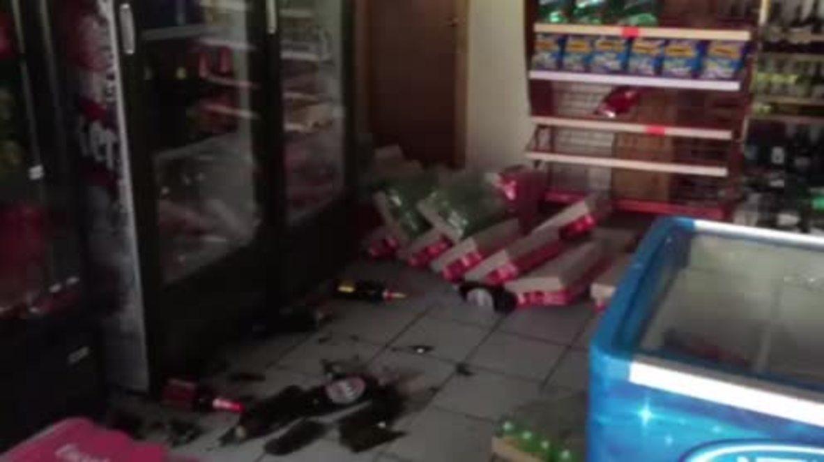 Chile: 7.7M earthquake rocks supermarket in Quellon