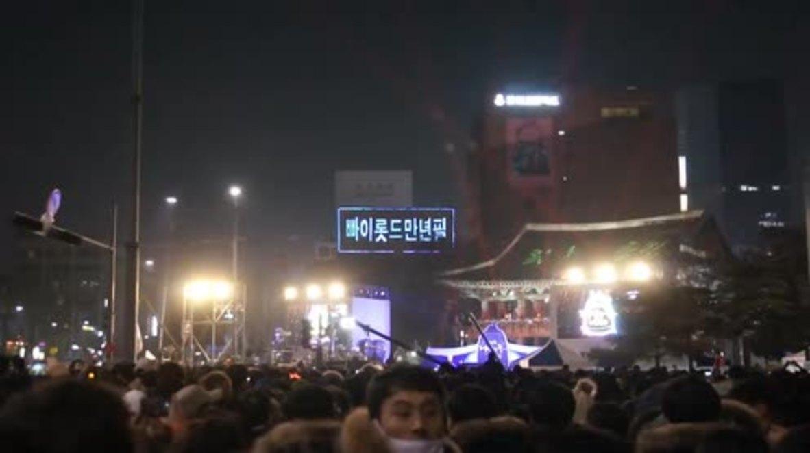 South Korea: Protesters demand president's resignation as clock strikes 12 on NYE