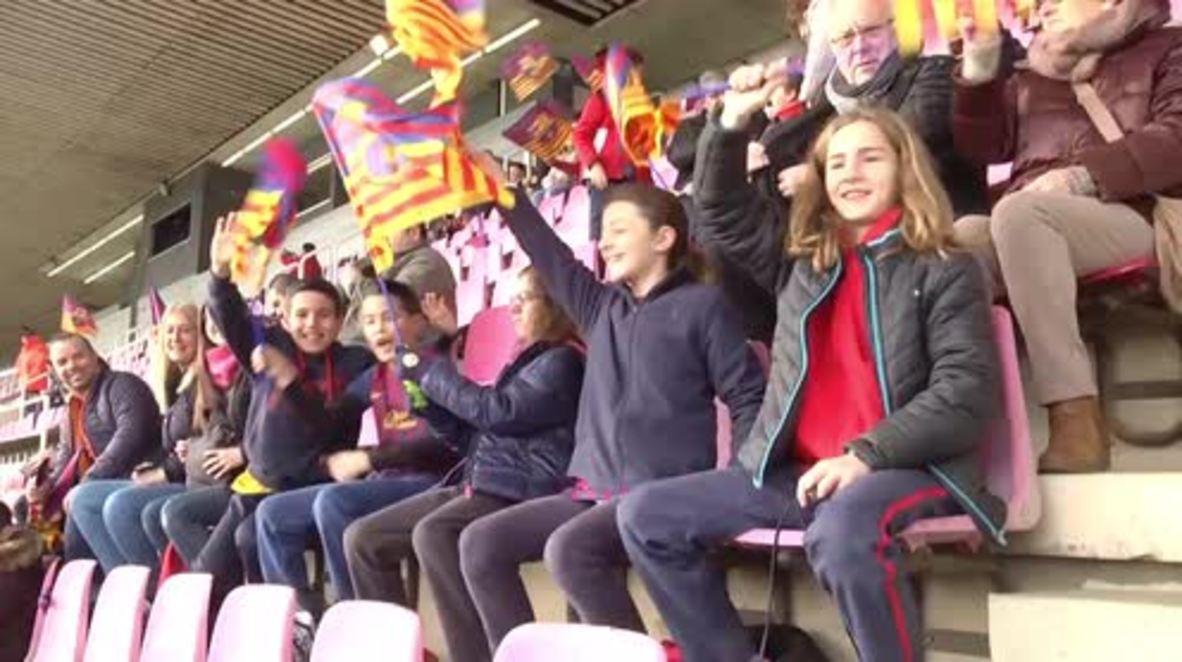 Spain: FC Barcelona fans watch Messi & co train following holiday break