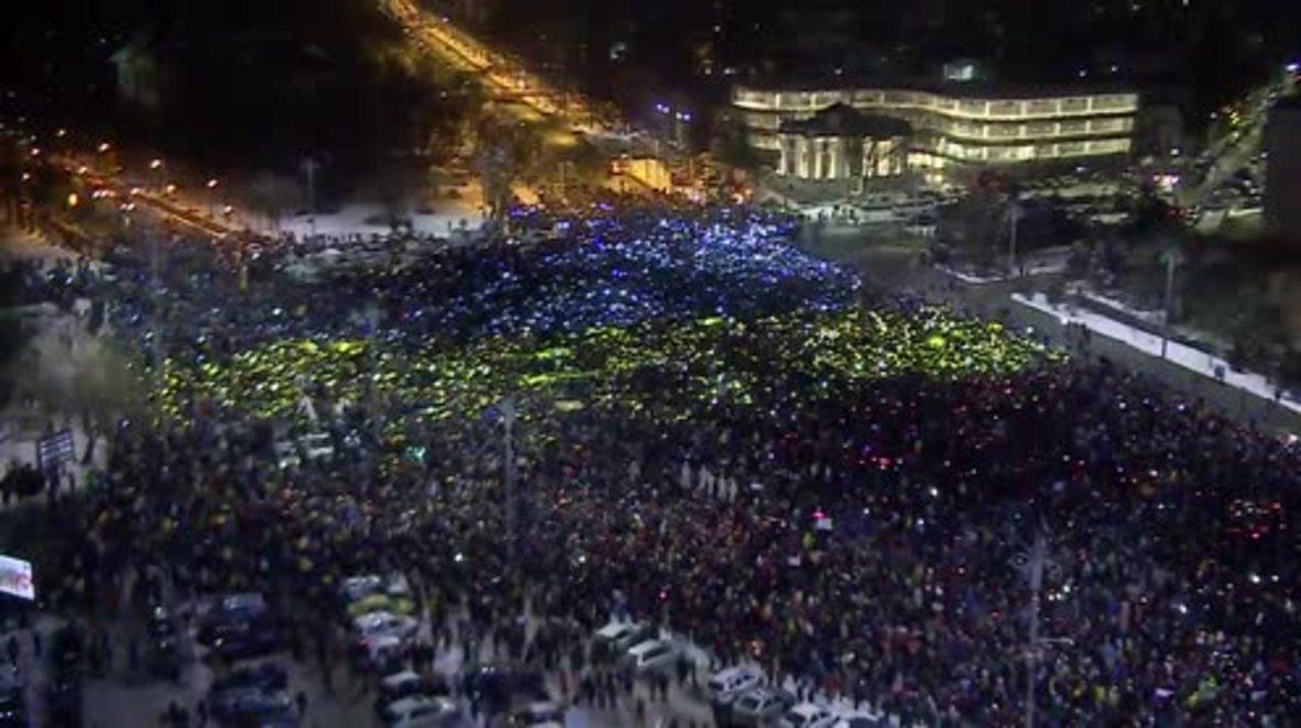 Romania: Protesters recreate massive Romanian flag on Victory Square