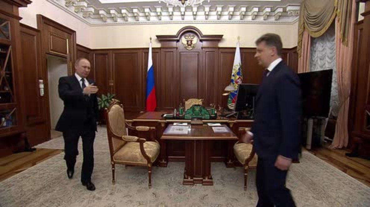 Russia: Transport minister tells Putin work on Crimea's Kerch Strait Bridge 'on schedule'