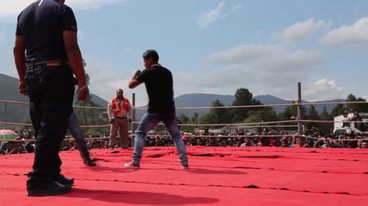 Guatemala: A Good Friday for a fight Guatemalan men battle in Chivarreto