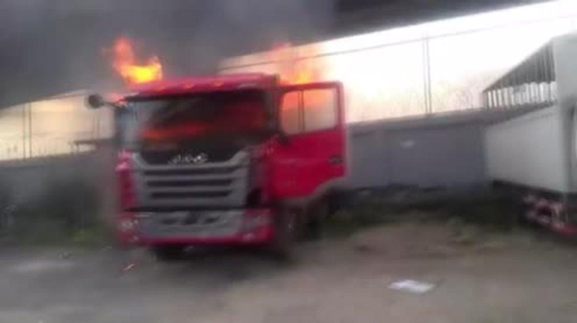 Venezuela: Trucks burn as anti-govt. protests enter fourth week