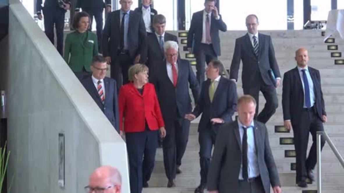 Germany: Merkel says refugees must abide by rules of 'German humanity' in volunteer address