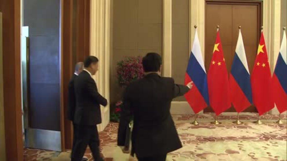 China: Putin discusses economic ties with Xi Jinping