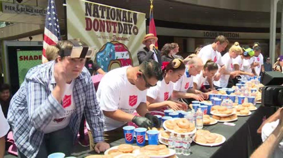 USA: New world record set at doughnut eating contest, Santa Monica