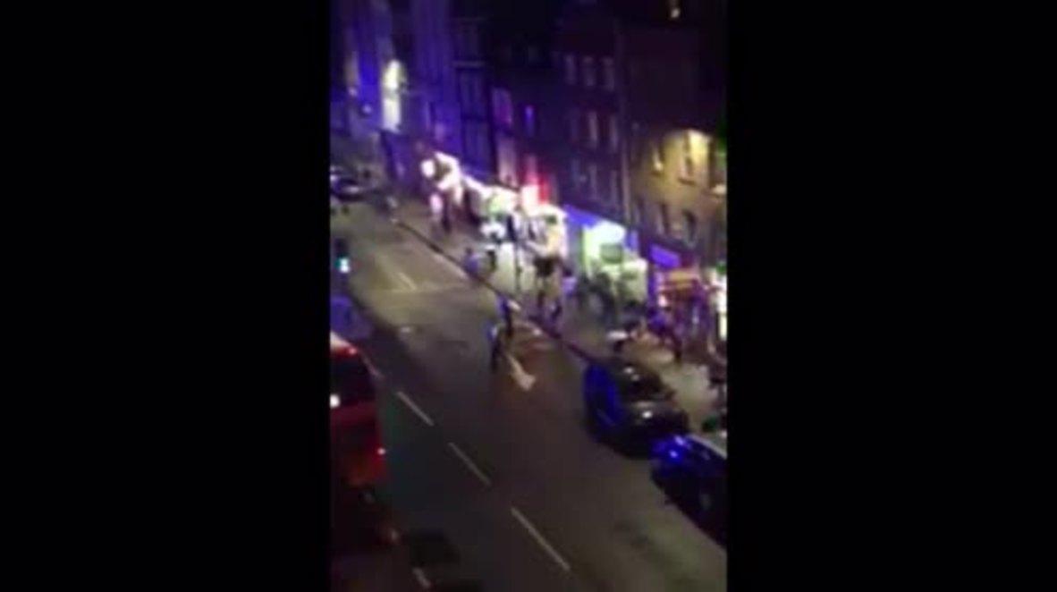 UK: Eyewitness heard 'six gunshots' as crowds flee scene of attack