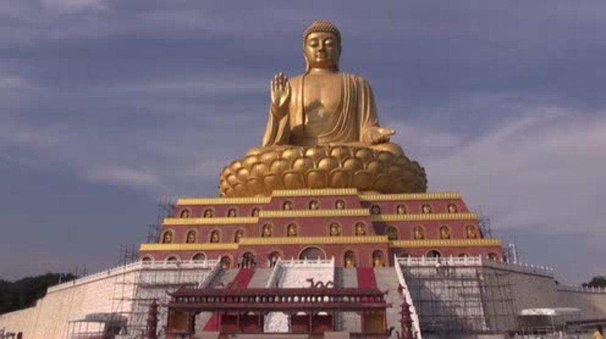 China: Gargantuan decade-long Buddha construction STILL not finished