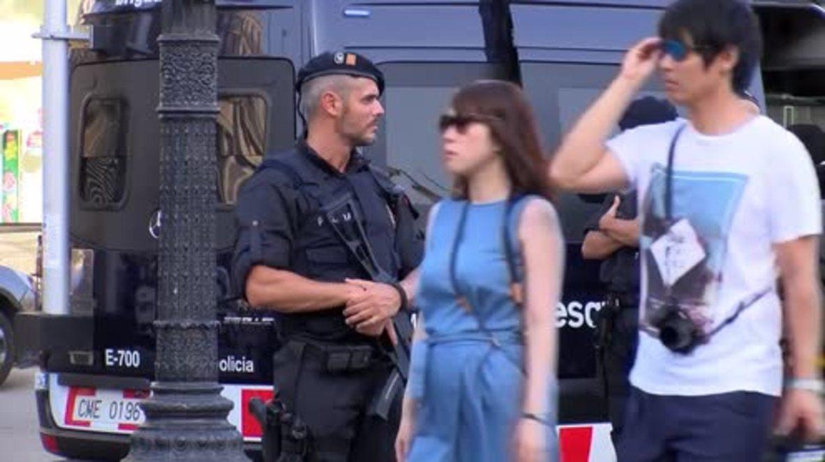 Spain: Armed police patrol Las Ramblas as tourists return to Barcelona streets