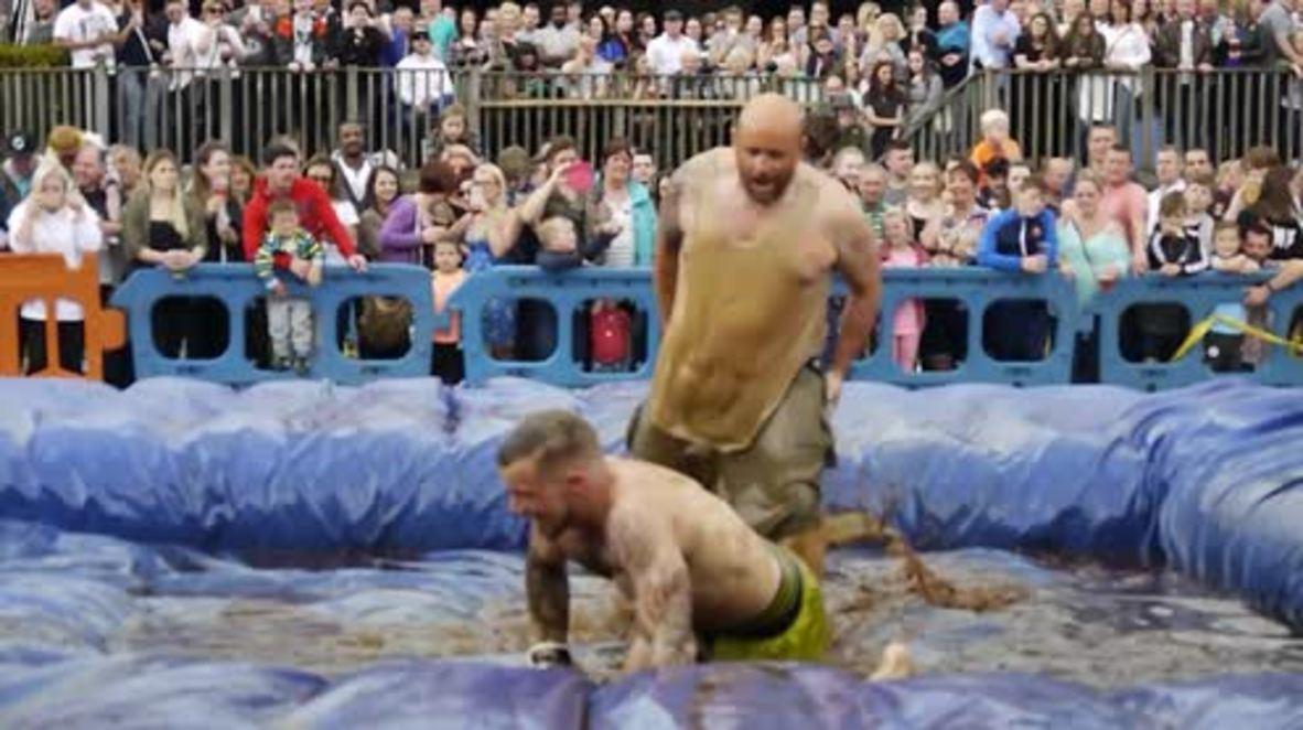 WATCH wacky fighters sliding around at World Gravy Wrestling Championship