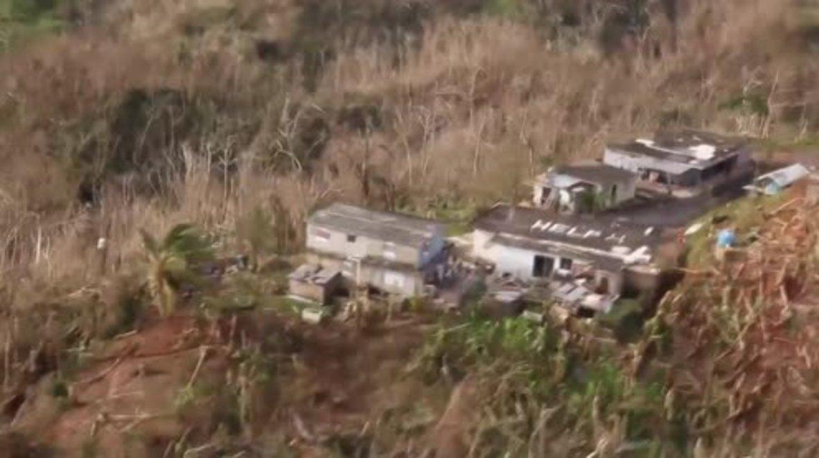 Puerto Rico: 'HELP '- Rescue team responds to desperate plea by Maria-stricken family
