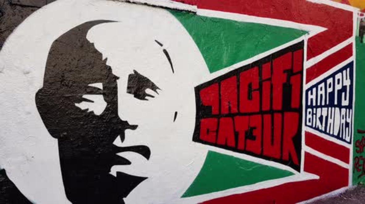 Putin murals appear in European cities ahead of Russian President's 65th birthday *STILLS*