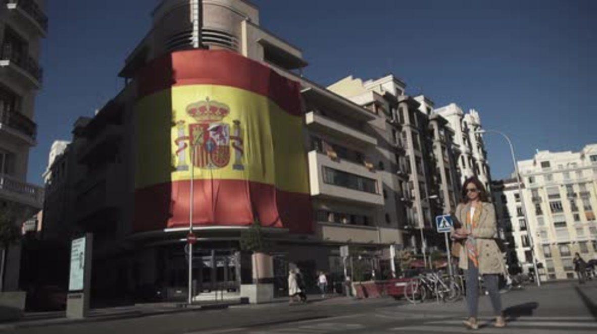 Spain: Massive Spanish flag covers iconic Madrid nightclub