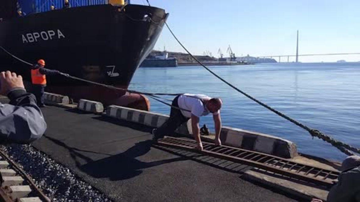 Break records, not backs - Watch Russian strongman pull 5000-TONNE vessel in Vladivostok