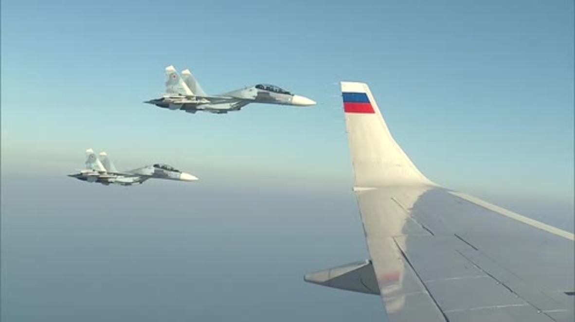 International airspace: Military jets escort Putin on surprise visit to Khmeimim Air Base