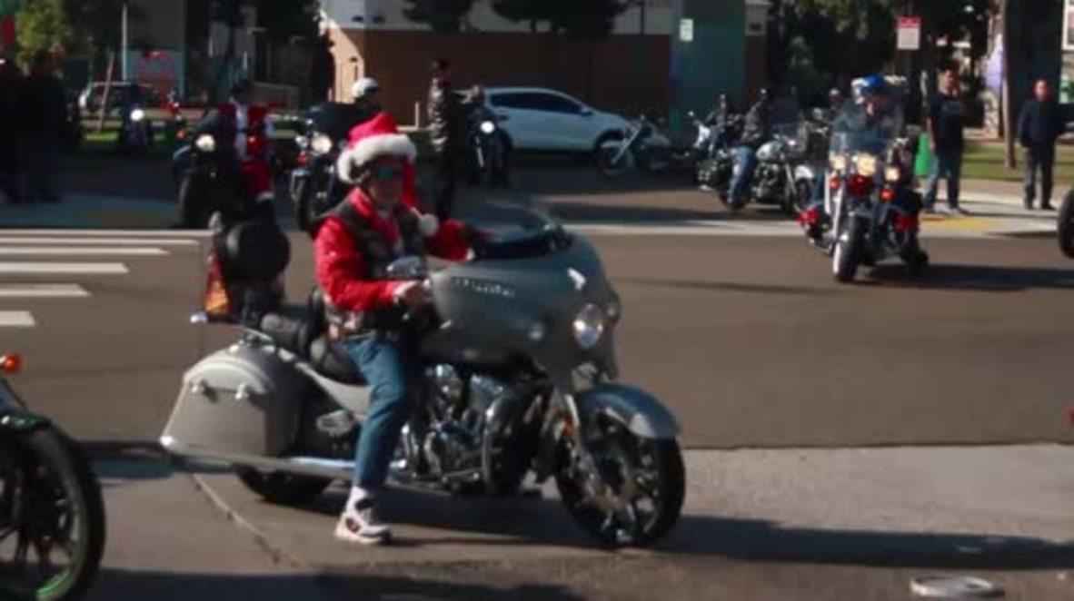 Mexico: Santa bikers roar into Tijuana armed with toys