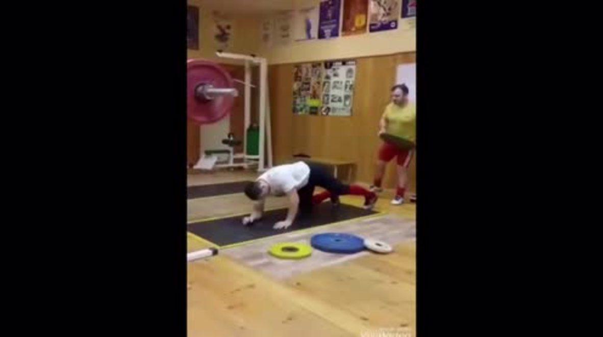 Pressure...pushing down on me? Russian man carries 200kg in Herculean PLANK