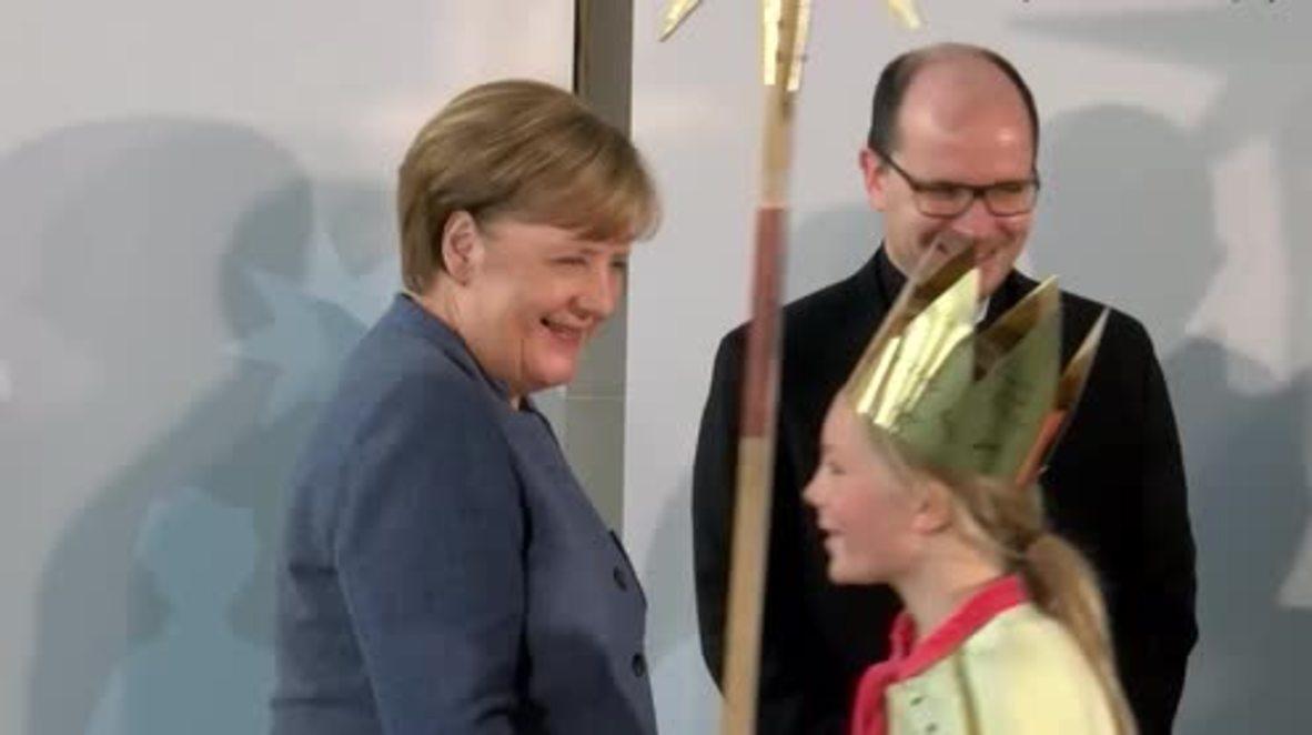 Germany: Merkel sings alongside children dressed as biblical Magi in Berlin