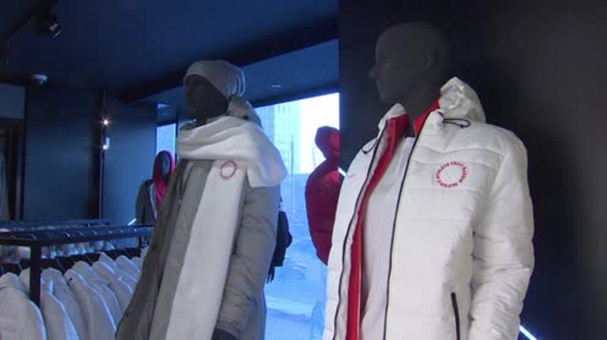 Russia: Winter Olympic team unveil 'neutral' uniform