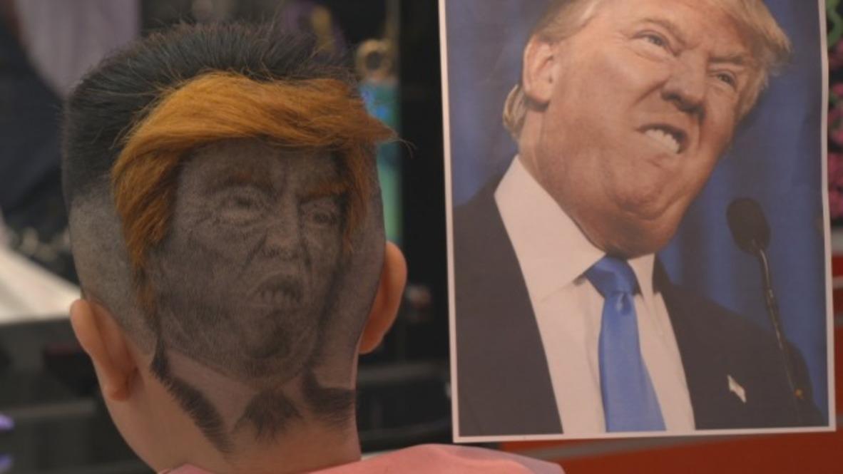 Hair on fleek! - Barber styles clients' hair with Trump or Putin's face