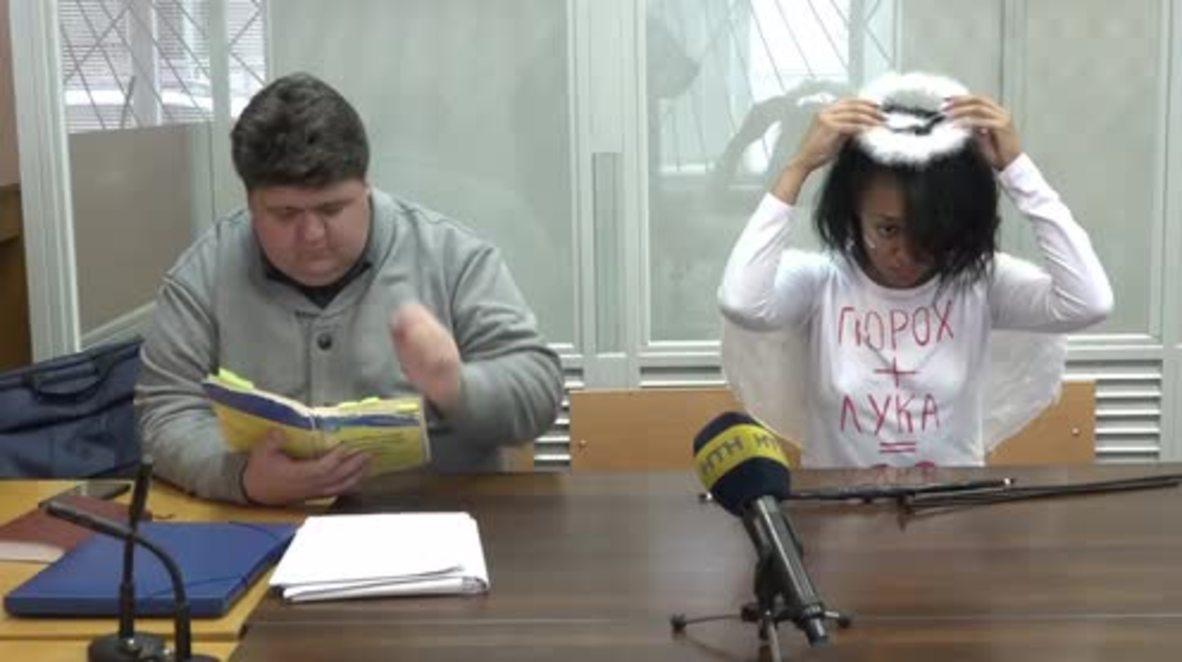Ukraine: FEMEN activist dresses as cupid for Valentine court hearing