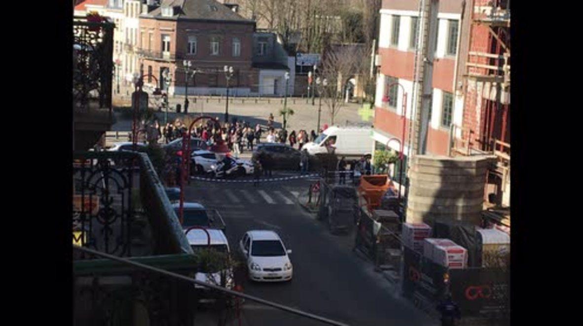 Bélgica: Policía armada se despliega en un suburbio de Bruselas a la caza de un hombre armado *FOTOGRAFÍAS*
