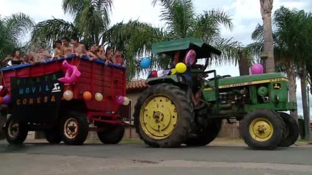 Havin' a splash! Kids in Conesa ride their dream SWIMMING cart