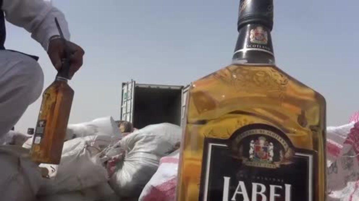 Afghanistan: Kandahar police burn huge 26-ton drug and bomb haul