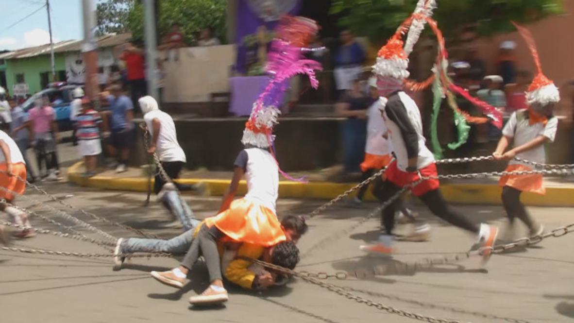 Nicaragua: Shackled men dragged through street in biblical scenes