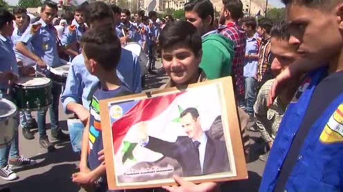 Siria: Residentes de Damasco marchan en apoyo a las fuerzas armadas sirias