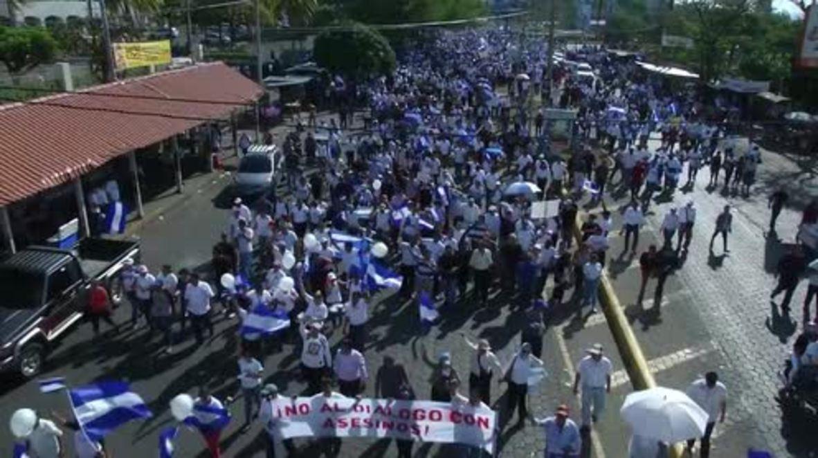 Nicaragua: Managua mass march urges non-violence after govt. scraps unpopular reforms