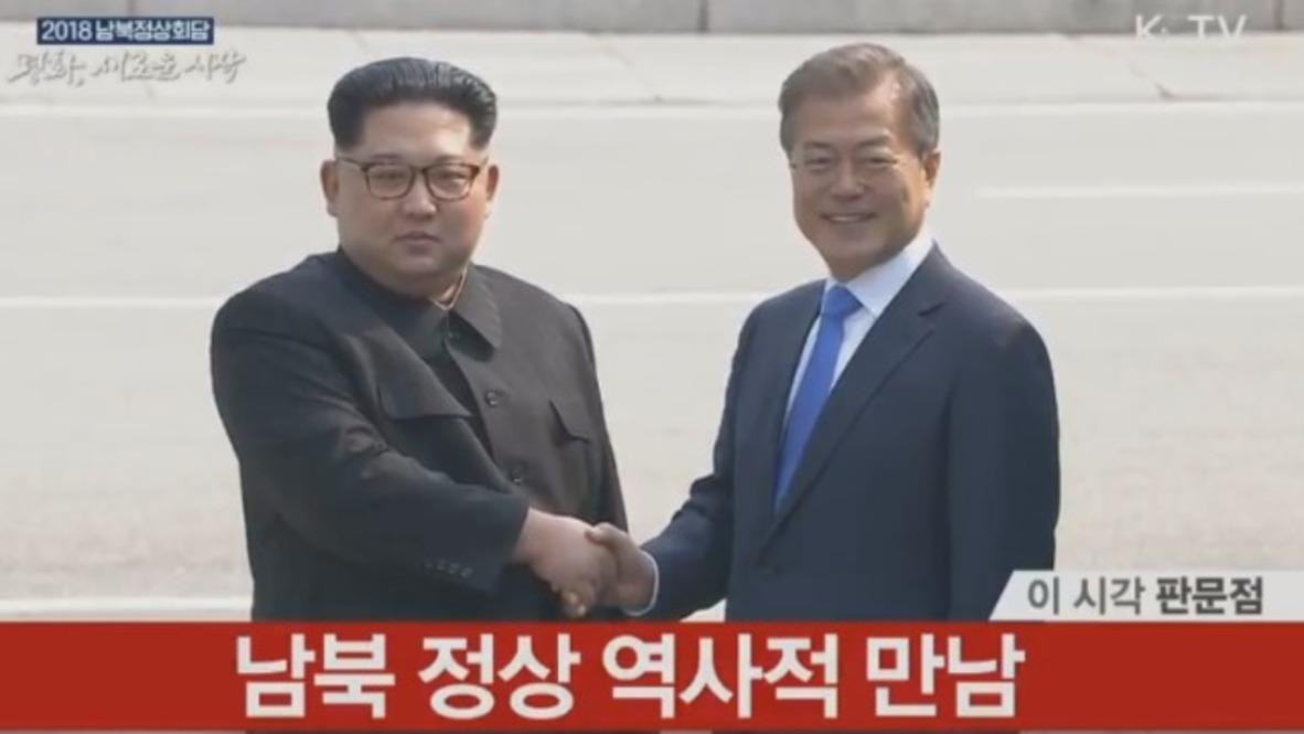 Korean DMZ: Kim Jong-un and Moon Jae-in shake hands ahead of historic summit