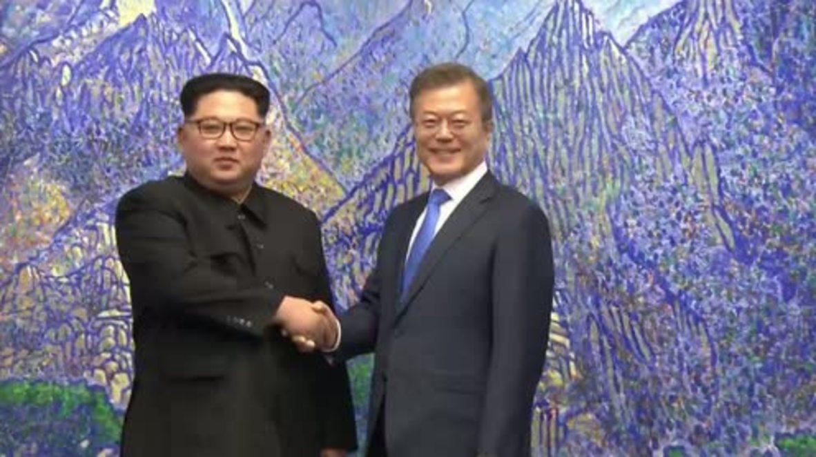 Korean DMZ: Kim Jong-un and Moon Jae-in talk at Panmunjom round table *CLEAN*