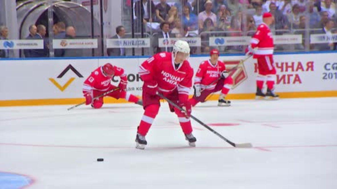Five star Putin hits ice at Night Hockey League match