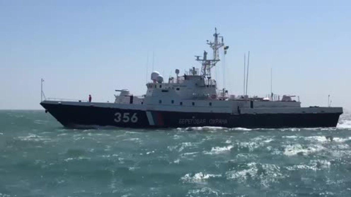 Russia: Crimean citizens witness ships set to guard Crimean Bridge