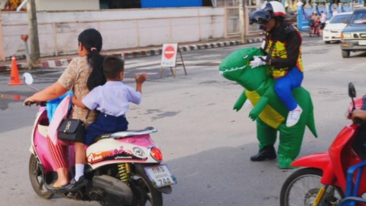 Think-he-sauraus speeding?! T-REX controls roaring Thai traffic
