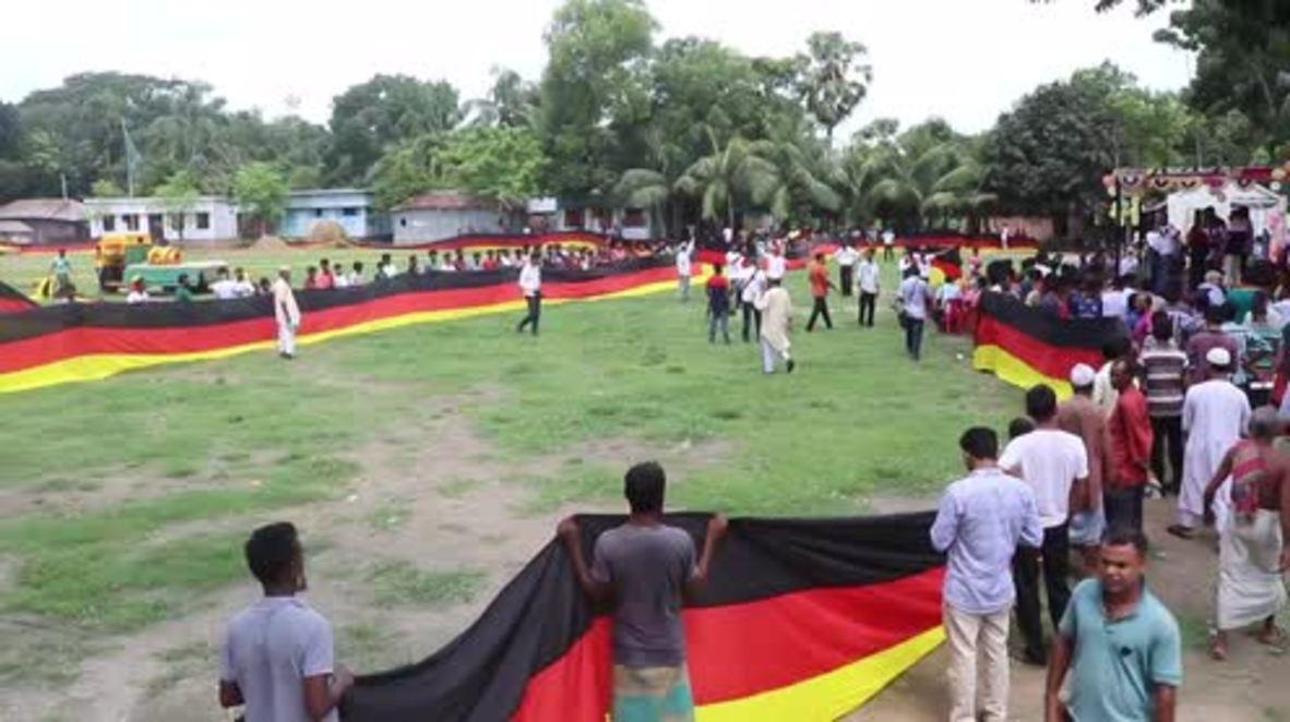 Bangladesh: Un hombre vende sus tierras para construir la bandera alemana más grande del mundo antes del Mundial