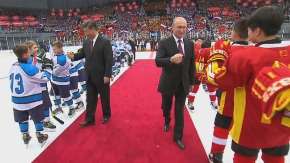 China: Putin and Xi Jinping attend Russia vs. China junior ice hockey match