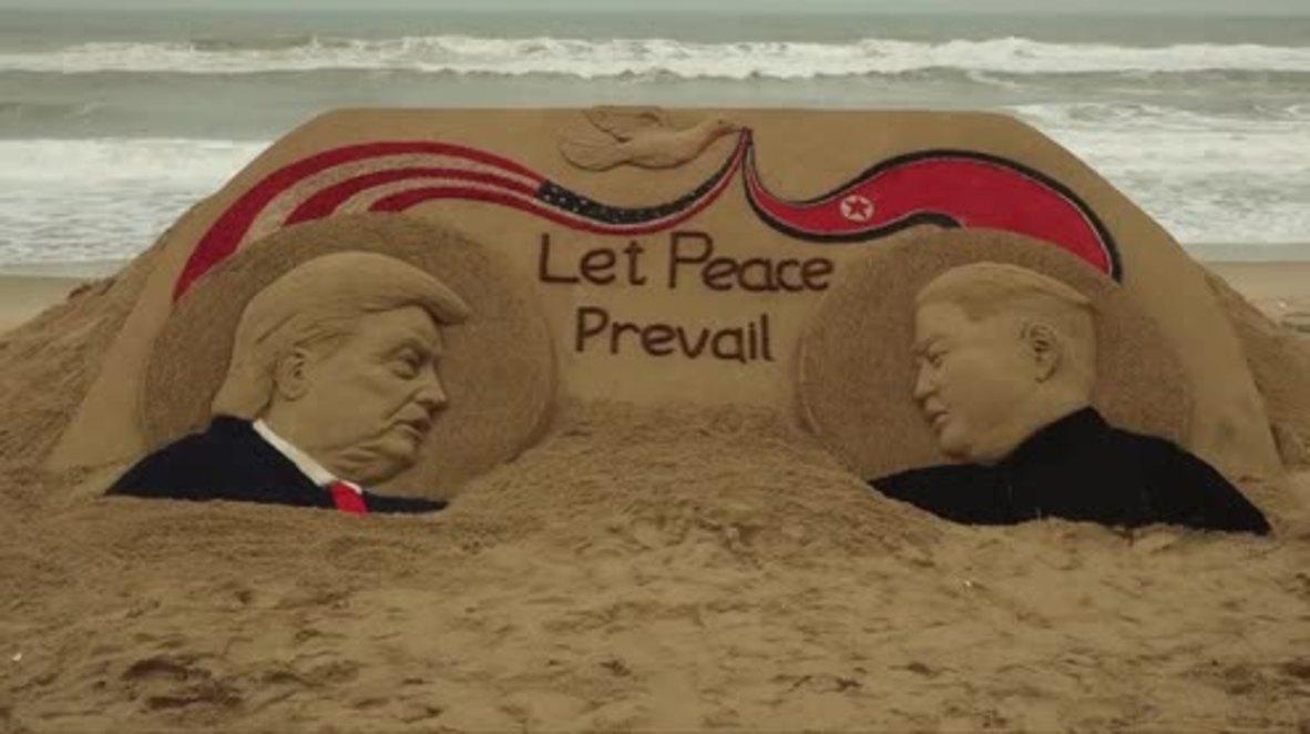 Trump, Kim sand sculpture celebrates peace ahead of summit