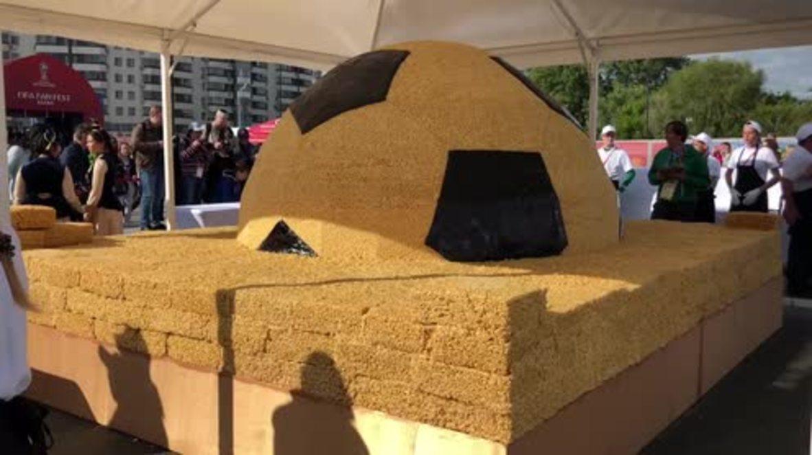 Russia: Giant chak-chak football desert commemorate WC kick-off