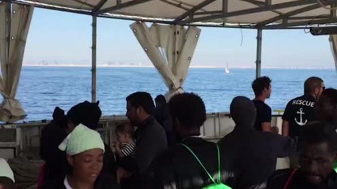 Spain: Migrants leave Aquarius upon docking in Valencia port