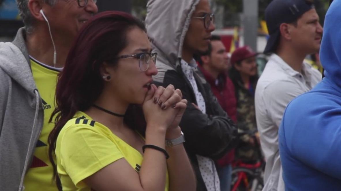 Colombia: Los aficionados colombianos lamentan la derrota de su equipo en la Copa del Mundo