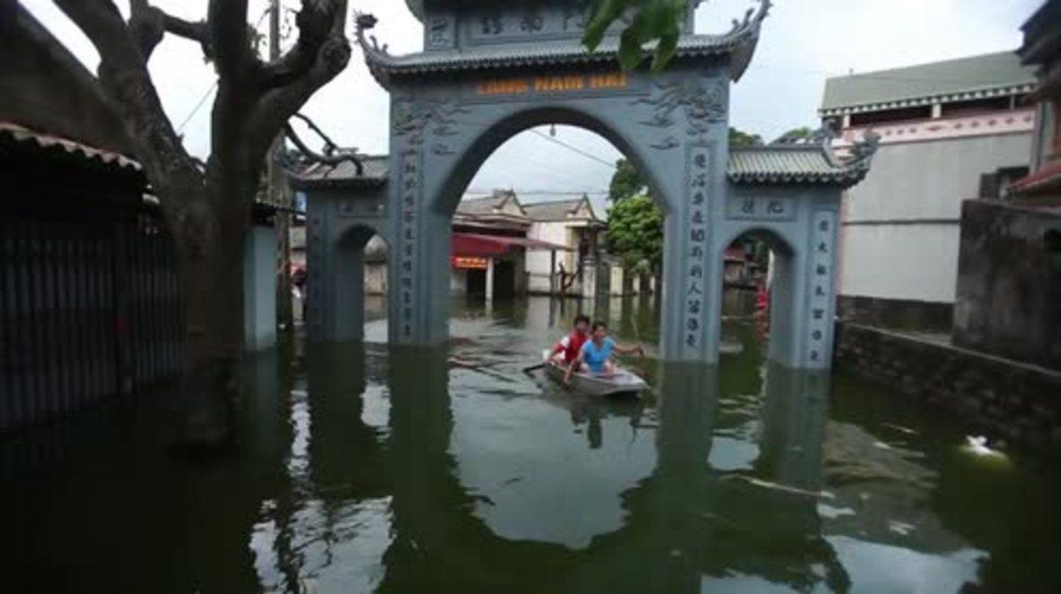 Vietnam: Three killed, thousands evacuated as flooding hits Hanoi suburb