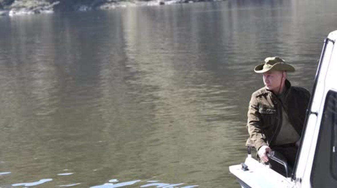 Russia: Putin enjoys beauty of Yenisei River during vacation in Tuva *STILLS*