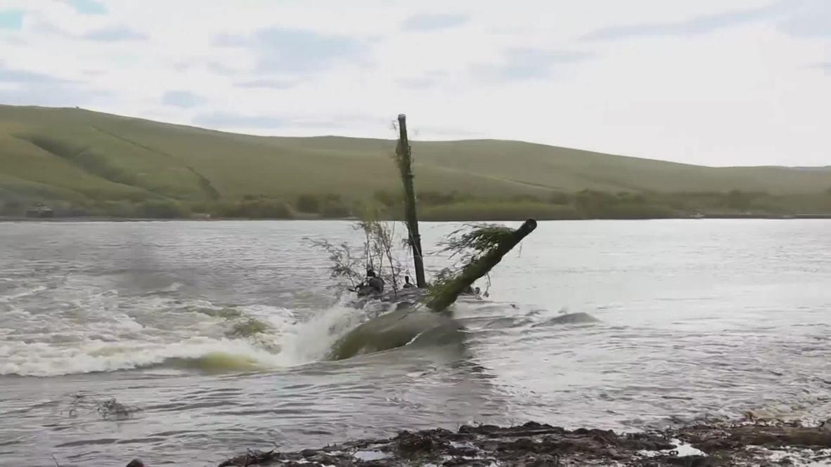 Russia: Tanks breach river during Vostok 2018 exercises