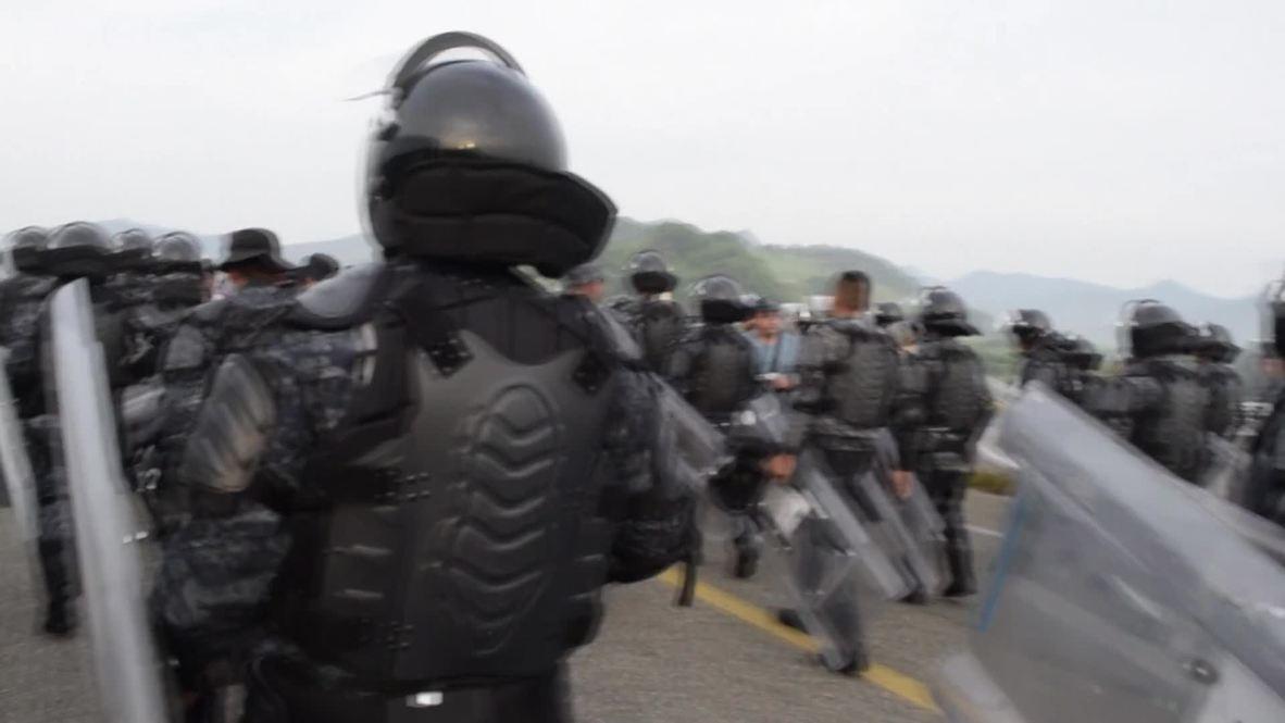 Mexico: Police abandon blockade of migrant caravan