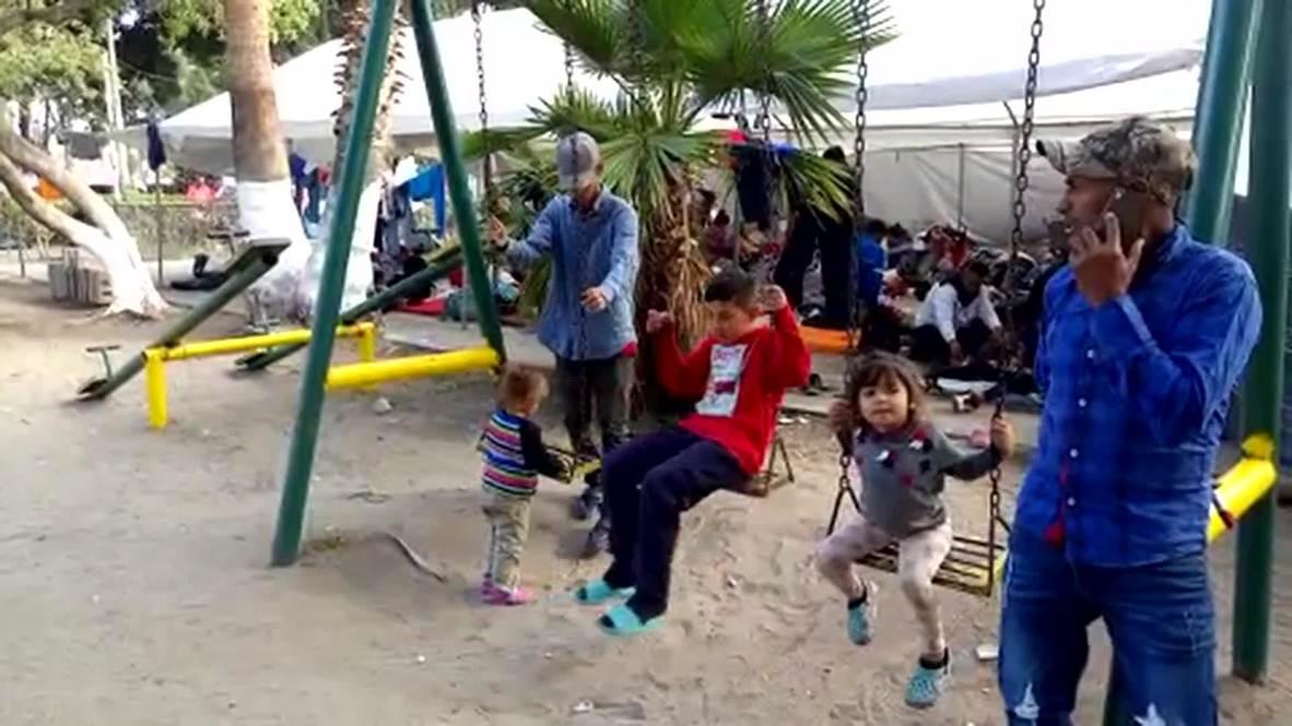 Mexico: Hundreds of migrants set up camp at Tijuana's US border